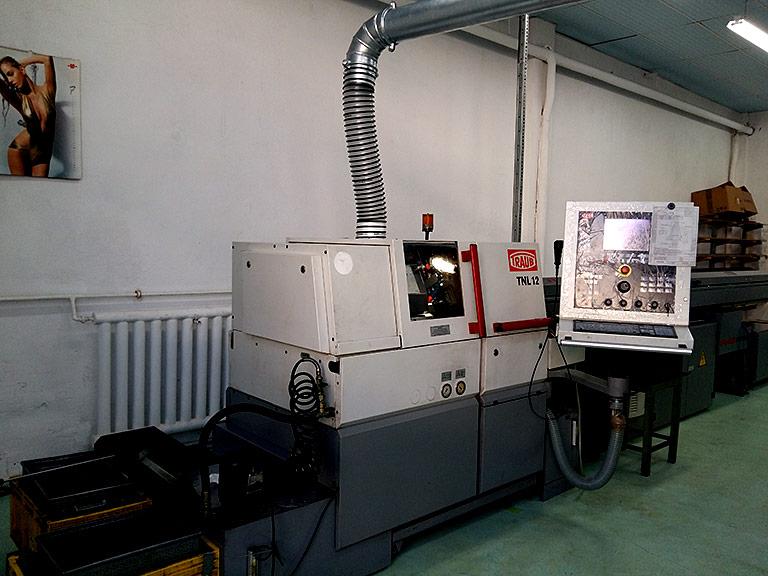 Strung TRAUB TNL 12 dotat cu echipament de filtrare vapori ulei